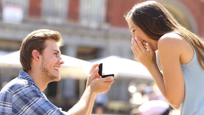 Man proposes to his fiancé on a street in Chester