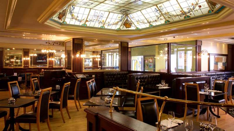Interior Image of La Brasserie has a striking hand-painted glass skylight