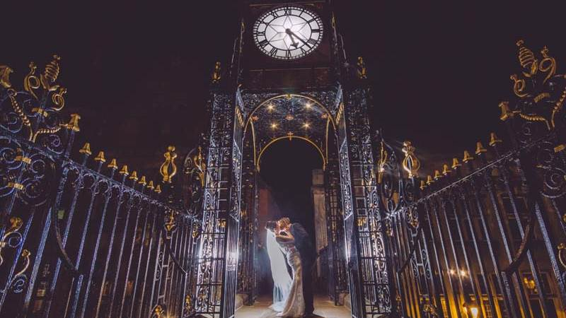 Newly Weds Kiss under Chester Clock
