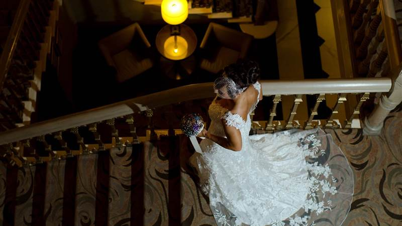 Bride rushes down stairwell in Chester